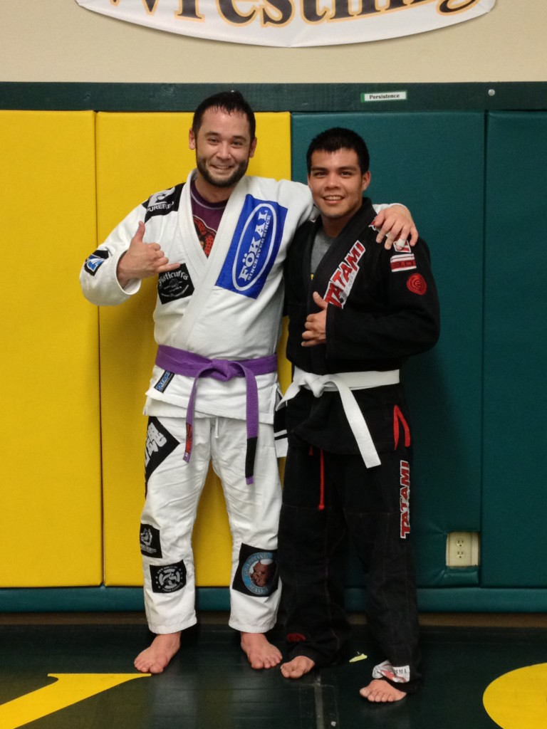 Timmy Silvas getting his first stripe with Quincy Brazilian Jiu-Jitsu