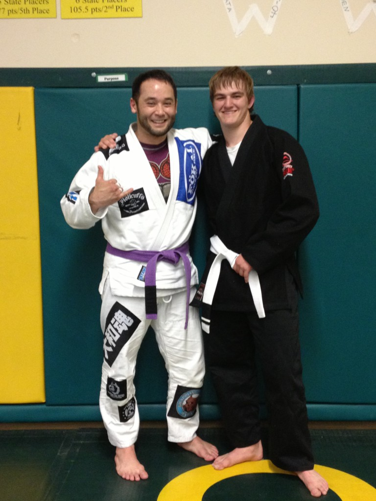 Jayden Elmore getting his first stripe at Quincy Brazilian Jiu-Jitsu