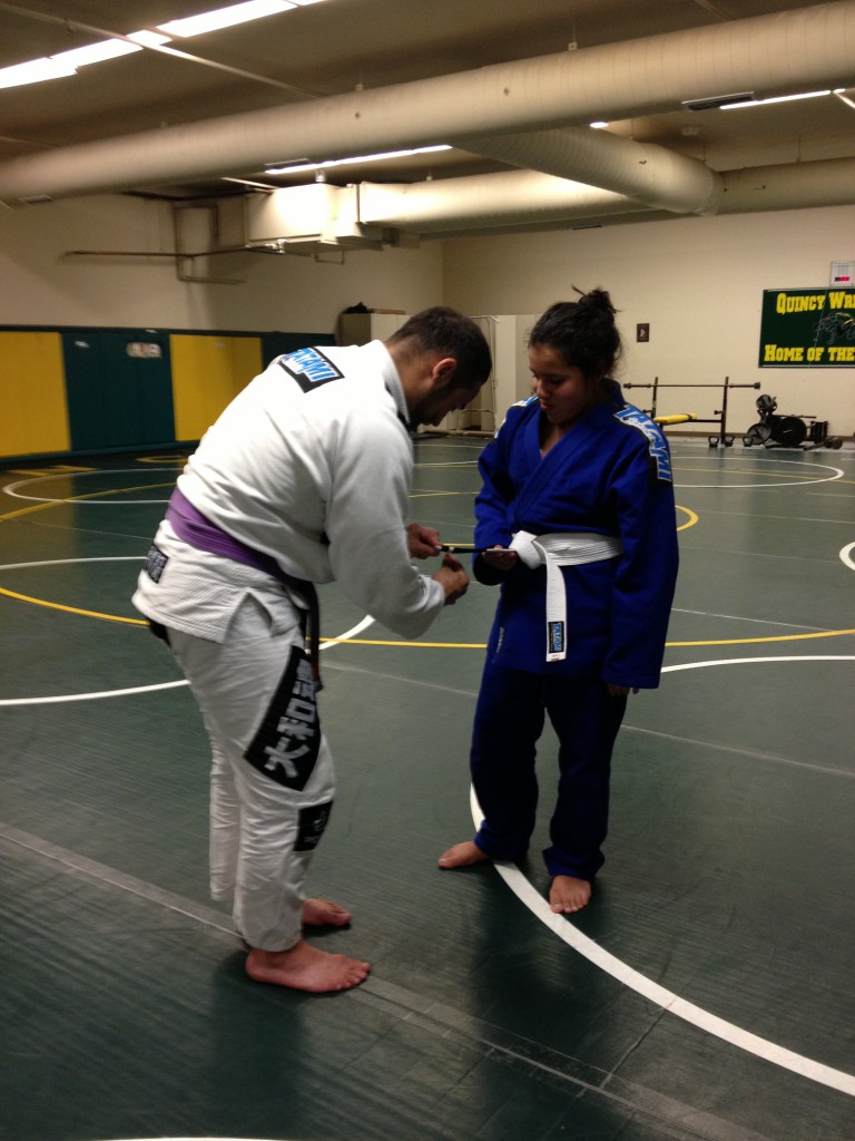 Julisa getting her first stripe at Quincy Brazilian Jiu-Jitsu