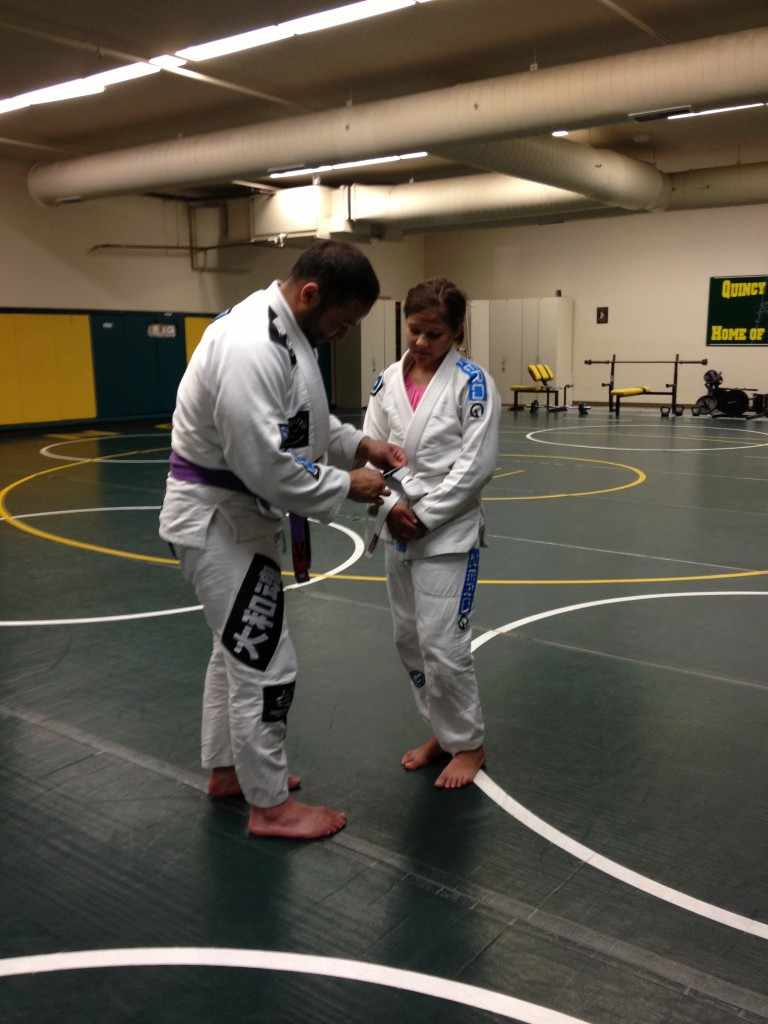 Jaselyn getting her first stripe at Quincy Brazilian Jiu-Jitsu