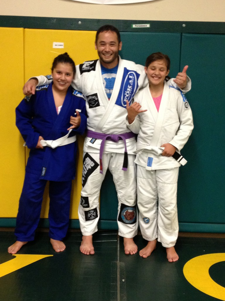 Julisa and Jaselyn getting their first stripes at Quincy Brazilian Jiu-Jitsu