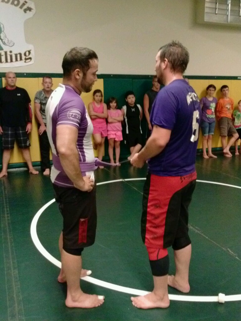 Coach Pipes getting his first stripe on his Purple Belt