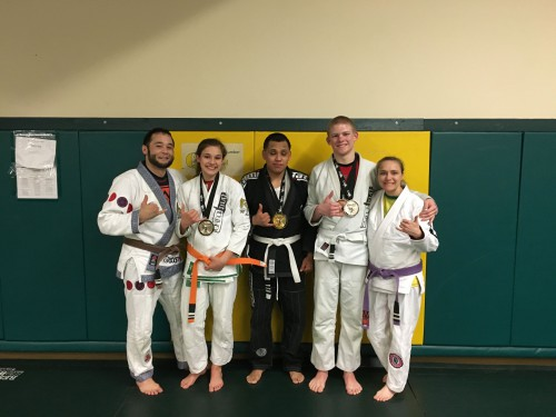 Jaselyn, Gustavo and Hunter presenting their medals to Quincy Brazilian Jiu-Jitsu