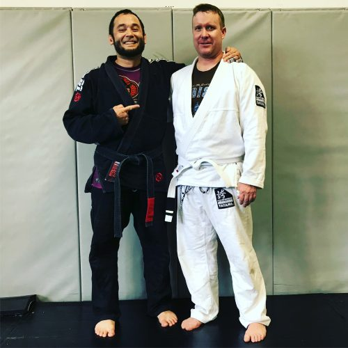 Professor Jeremy Seda pointing to Jon, who earned his first stripe from Quincy Brazilian Jiu-Jitsu today