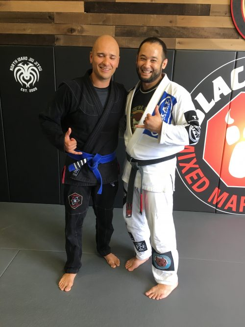 Juan earning his fourth stripe on his blue belt