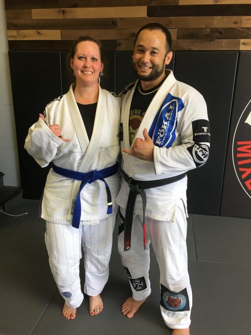 Amber earning her first stripe on her blue belt
